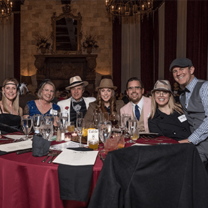 Toledo Murder Mystery party guests at the table
